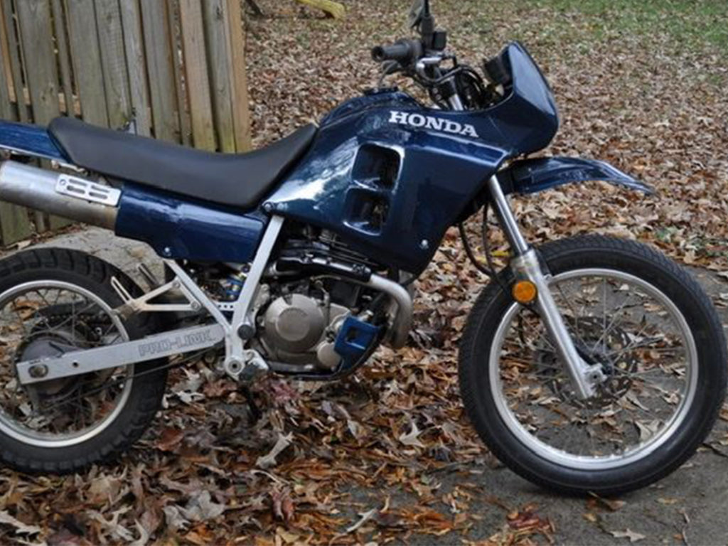 Vintage Honda motorcycle parked in a lot