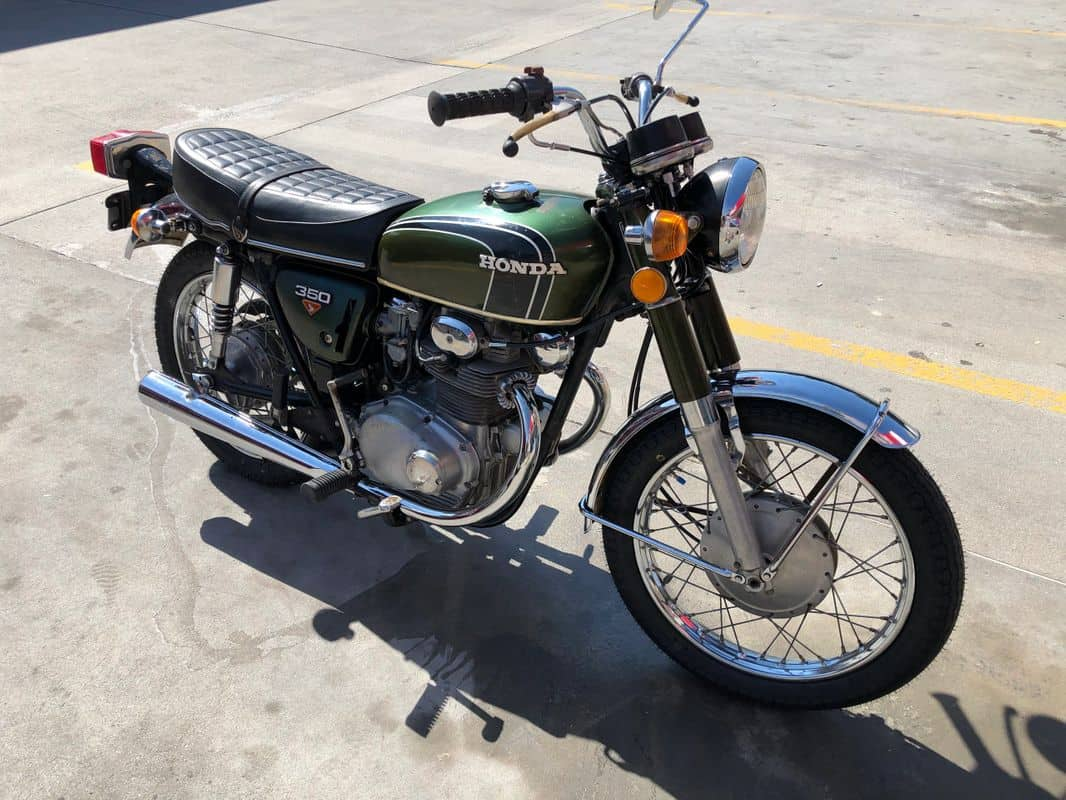 Vintage Honda motorcycle parked in an empty parking lot